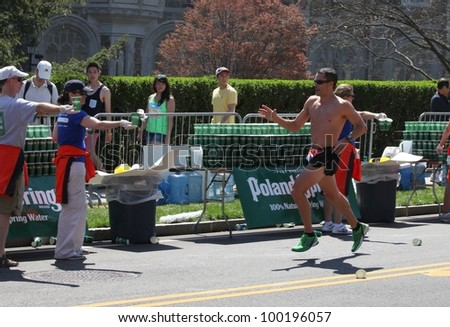 BOSTON - APRIL 16 : Volunteers gave water to runners during the Boston Marathon on April 16, 2012 in Boston. Wesley Korir (Kenya) finished first with a time of 2:12:40. - stock photo