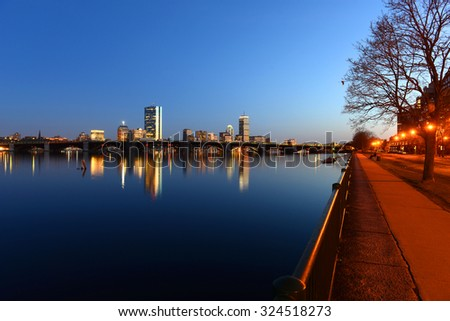 Boston Back Bay Skyline John Hancock Tower and Prudential Center night scenes, viewed from Cambridge, Boston, Massachusetts, USA - stock photo