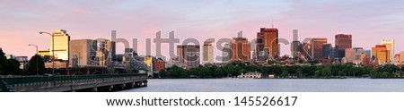 Boston Charles River sunset panorama with urban skyline and skyscrapers with highway bridge. - stock photo