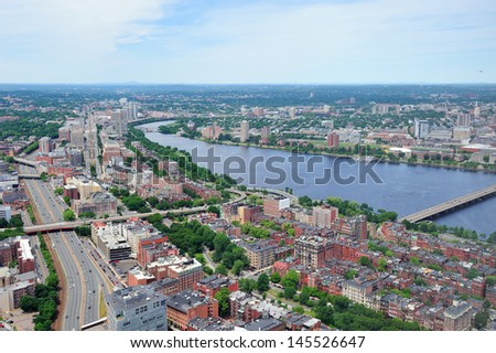 Boston city aerial view with urban buildings and highway with Charles River in Cambridge district. - stock photo