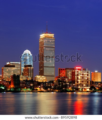 Boston city skyline at dusk with prudential tower and urban