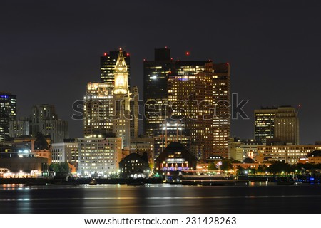 Boston City Skyscrapers, Custom House and Boston Waterfront at night from East Boston, Boston, Massachusetts, USA - stock photo