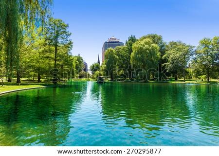 Boston Common lake and skyline in Massachusetts USA - stock photo