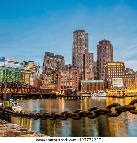 Boston Harbor and Financial District at twilight in Boston, Massachusetts. - stock photo
