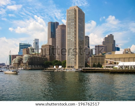 Boston harbor skyline on a beautiful summer day from the ocean - stock photo