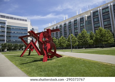 BOSTON - JUNE 06: Red Sculpture in front of Ray and Maria Stata Center on the campus MIT. Photo taken on June 06, 2014 in Cambridge, Massachusetts, USA.  - stock photo