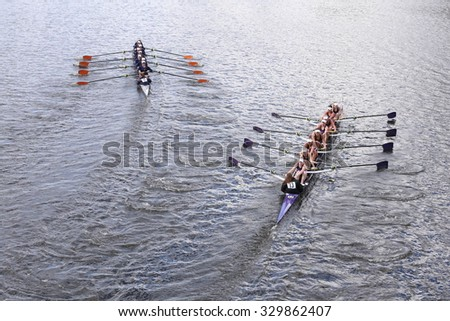 BOSTON - OCTOBER 18, 2015: Albany (left) and Mount Saint Joseph races in the Head of Charles Regatta Women's Youth Eights - stock photo