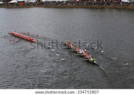 BOSTON - OCTOBER 19, 2014: Boston University (left) and Yale (right)  races in the Head of Charles Regatta Women's Championship Eights - stock photo