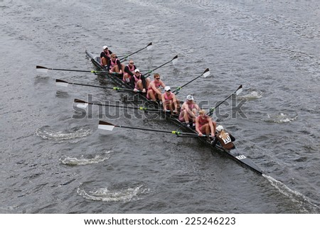 BOSTON - OCTOBER 19, 2014: Brown University races in the Head of Charles Regatta Men's Championship Eights, Craftsbury Sculling Center won with a time of 14:20 - stock photo