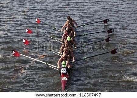 BOSTON - OCTOBER 21: Burnt Hills Rowing Association races in the Head of Charles Regatta, Marin Rowing Association won with a with a time of 12:59 on October 21, 2012 in Boston, MA. - stock photo
