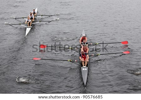 BOSTON - OCTOBER 23: Camp Randall Rowing Club(R) and Merrimac River Rowing Club (L) Mens Fours races in the Head of Charles Regatta on October 23, 2011 in Boston, MA. - stock photo