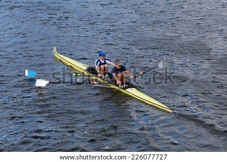 BOSTON - OCTOBER 19, 2014: CBC rowing with Eric Lev and Joe Linhoff race in the Head of Charles Regatta Men's Master Doubles, 612endurance Rowing won with a time of 18:58 - stock photo