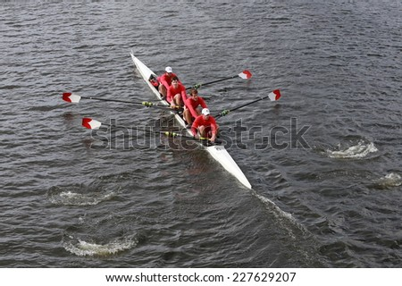 BOSTON - OCTOBER 19, 2014: Cornell Univerisity races in the Head of Charles Regatta Men's Championship Fours - stock photo