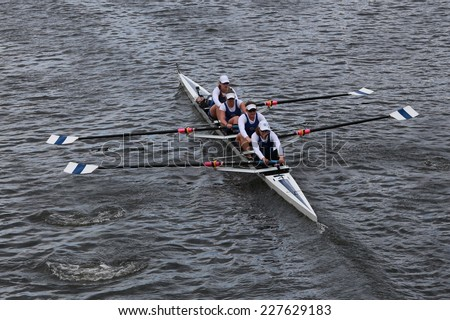 BOSTON - OCTOBER 19, 2014: Don Rowing races in the Head of Charles Regatta women's Championship Fours - stock photo