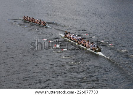 BOSTON - OCTOBER 19, 2014: Georgetown University (R) and New York Athletic Club(L) races in the Head of Charles Regatta Men's Championship Eights, Craftsbury Sculling Center won with a time of 14:20 - stock photo