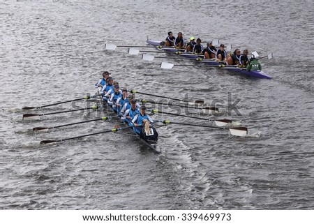 BOSTON - OCTOBER 18, 2015: Headington (left) RMY Queens (Right) races in the Head of Charles Regatta Women's Youth Eights [PUBLIC RACE] - stock photo