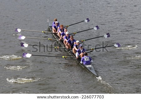 BOSTON - OCTOBER 19, 2014: Holy Cross team races in the Head of Charles Regatta Men's Championship Eights, Craftsbury Sculling Center won with a time of 14:20 - stock photo