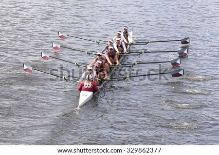 BOSTON - OCTOBER 18, 2015: Holy Names Academy races in the Head of Charles Regatta Women's Youth Eights [PUBLIC EVENT] - stock photo