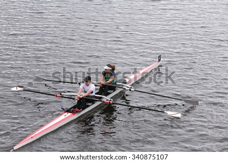 BOSTON - OCTOBER 18, 2015: MelbU Unaff  Composite races in the Head of Charles Regatta Women's Master Doubles [PUBLIC RACE] - stock photo
