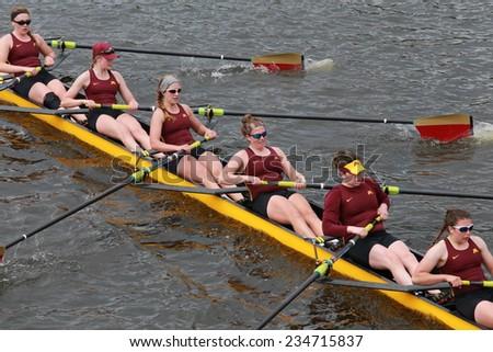 BOSTON - OCTOBER 19, 2014: Minnesota University races in the Head of Charles Regatta Women's Championship Eights - stock photo