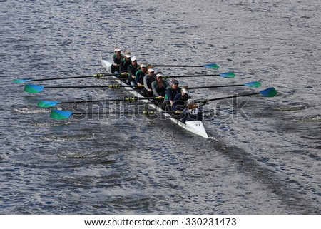 BOSTON - OCTOBER 18, 2015: New Trier Rowing Club races in the Head of Charles Regatta Women's Youth Eights - stock photo
