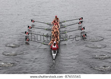 BOSTON - OCTOBER 23: North Eastern women's Eights races in the Head of Charles Regatta.  Williams College won with a time of 14:17 on October 23, 2011 in Boston, MA. - stock photo