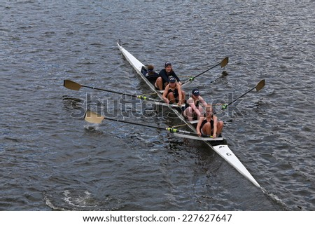 BOSTON - OCTOBER 19, 2014: Notre Dame University races in the Head of Charles Regatta women's Championship Fours - stock photo