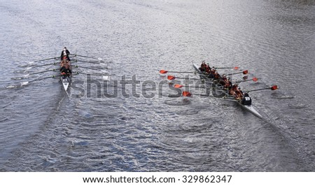 BOSTON - OCTOBER 18, 2015: Old Dominion (left) and Wayland-Weston (right) races in the Head of Charles Regatta Women's Youth Eights - stock photo