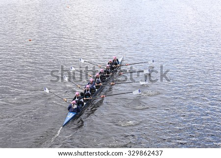 BOSTON - OCTOBER 18, 2015: Sarasota Crew races in the Head of Charles Regatta Women's Youth Eights - stock photo