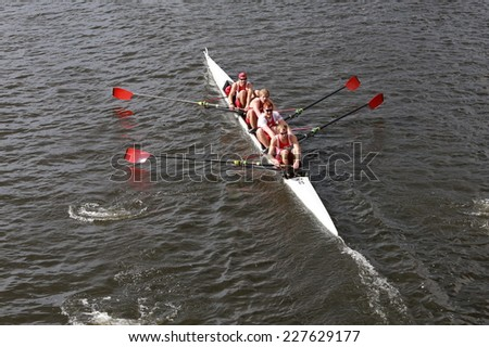 BOSTON - OCTOBER 19, 2014: University of Wisconsin races in the Head of Charles Regatta Men's Championship Fours - stock photo