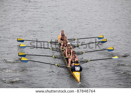 BOSTON - OCTOBER 23: US Naval Academy women's Eights races in the Head of Charles Regatta. Williams College won with a time of 14:17 on October 23, 2011 in Boston, MA. - stock photo