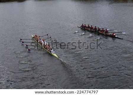 BOSTON - OCTOBER 19, 2014: US Rowing (left) and Real Circulor Labradoers(right) race in the Head of Charles Regatta Men's Championship Eights, Craftsbury Sculling Center won with a time of 14:20 - stock photo