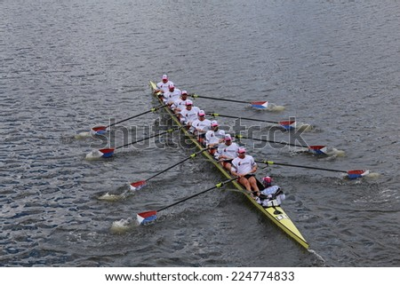 BOSTON - OCTOBER 19, 2014: US Rowing races in the Head of Charles Regatta Men's Championship Eights, Craftsbury Sculling Center won with a time of 14:20 - stock photo