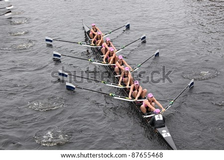 BOSTON - OCTOBER 23: Yale University women's Eights races in the Head of Charles Regatta.  Williams College won with a time of 14:17 on October 23, 2011 in Boston, MA. - stock photo