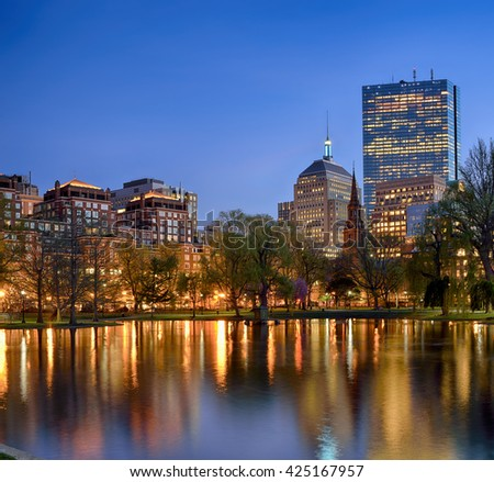 Boston Public Garden at night. City skyline and street lights reflections on water - stock photo