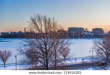 Boston's Charles River frozen with cross-country skiier - stock photo