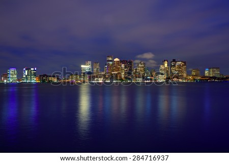 Boston skyline at sunset and river reflection in Massachusetts USA - stock photo