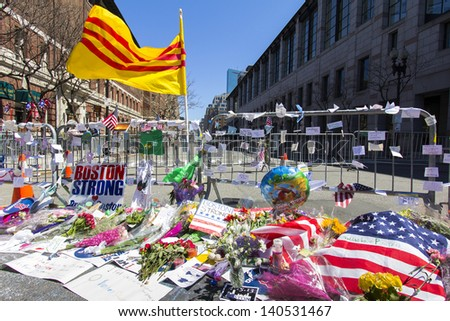 BOSTON, USA - APRIL 21: Locals and tourists left a lot of mementos and messages of courage at the several improvised memorials of the 2013 Boston Marathon bombing along Boylston st on April 21, 2013. - stock photo
