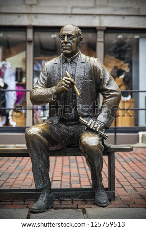 BOSTON, USA - JANUARY 19:Front view of the statue of former Celtics president Arnold Auerbach on January 19, 2013 in Boston. Arnold, as a basketball coach, won 938 games and 9 NBA championships. - stock photo