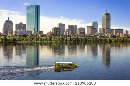 BOSTON, USA - JULY 20: Boston in MA, USA showcasing its mix of historic and modern skyscrapers, the Charles River, and an amphibian bus taking tourists for a ride on July 20, 2010. - stock photo
