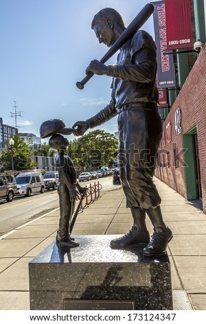 BOSTON, USA - JUNE 10: Famous Statue of legend baseball player Ted William in front of the Historic Ball Park Fenway Park Stadium in Boston, Massachusetts, USA on June 10, 2013. - stock photo