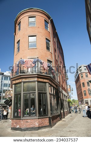 BOSTON, USA - OCTOBER 13; The renaissance style brick architecture of parts of the city seen in these buildings, America's oldest tavern,  Bell in Hand Tavern  on October 13, 2014, in Boston, USA  - stock photo