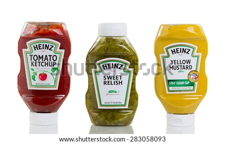 Bothell, Washington- May 31, 2015: Heinz products in squeezable plastic bottles consisting of Tomato ketchup, sweet relish (upright position), and yellow mustard. Isolated on white with reflection.  - stock photo
