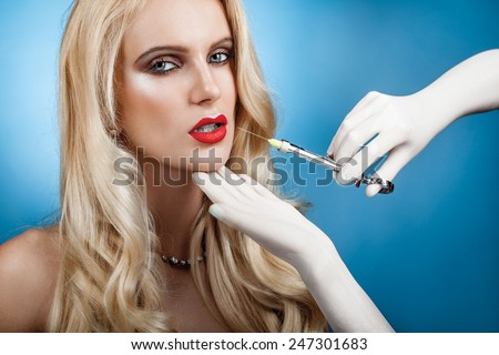 Botox injection beauty portrait of a woman with injector - stock photo