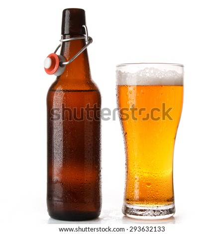 Bottle and glass of beer over white background - stock photo