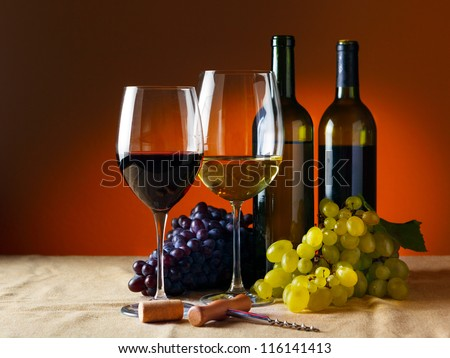 Bottle and glass of red wine - studio shot - stock photo