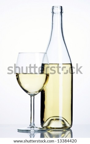 Bottle and glass of white wine - stock photo