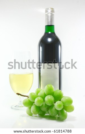 Bottle and glass of wine - stock photo