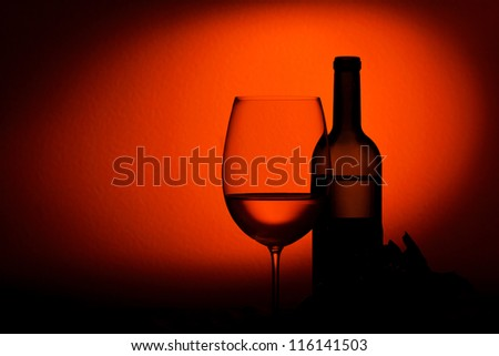 Bottle and glass of wine - studio shot - stock photo