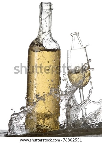 Bottle and glass with white wine splash - stock photo